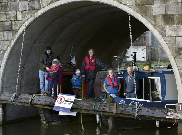 ROW: Protesters in Sallins, Co Kildare, assembled by the barrier placed across the canal by Waterways Ireland. From Left, Jerry Gleeson, Molloy Bawn Loughlin, Milon Loughlin, Ger Loughlin, Margaret Jordan and John Sheils. Photo: Tony Gavin