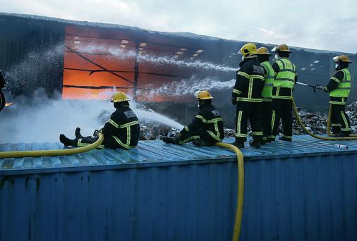 Firefighters battle the Oxigen blaze.