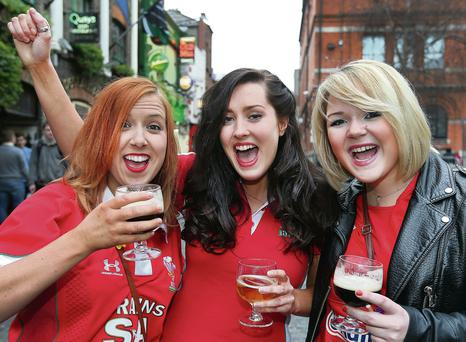 Welsh rugby fans Amy Jones, Francesca Grice and Alex Rees, all from Neath in Wales, enjoying Temple Bar in Dublin yesterday evening ahead of the match