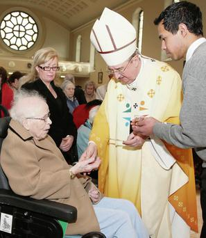 Archbishop Diarmuid Martin anointing a person with holy oils at the annual Dublin Diocesan World Day of the Sick Mass in the Church of St Therese in Mount Merrion