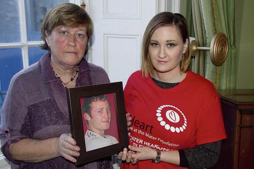Maureen Kelly and her daughter Eleanor hold up a picture of Darragh, who died of SADS when he was 21.