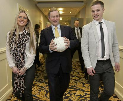 Siun Ni She, Taoiseach Enda Kenny and Padraig Og O Se arriving at the launch of the 'Phone watch Comortas Peile Paidi O Se 2014' Collins Photo: Michael Donnelly.