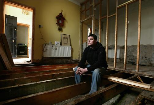 John Sparling in what was once the living room of his mother's house in the St Mary's area of Limerick