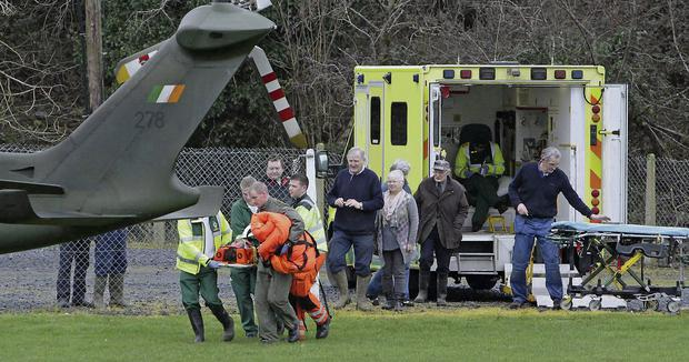 Mark Ranalow is moved from an ambulance to a helicopter before he was airlifted to hospital in Limerick after a serious accident involving a mini-digger Press 22