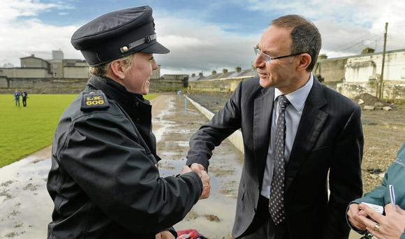 Republic of Ireland manager Martin O'Neill exchanges a handshake with Garda Niamh Briggs. Members of An Garda Siochana can do serious damage with their handshake according to Joe Donnelly.