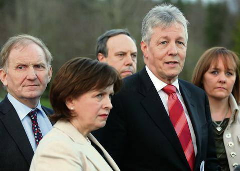 First Minister Peter Robinson (2nd right) speaks outside Stormont Castle, Belfast, as he has lifted his threat to resign over the controversy about on-the-run republicans after accepting the terms of a judicial review into the issue announced by the British Prime Minister