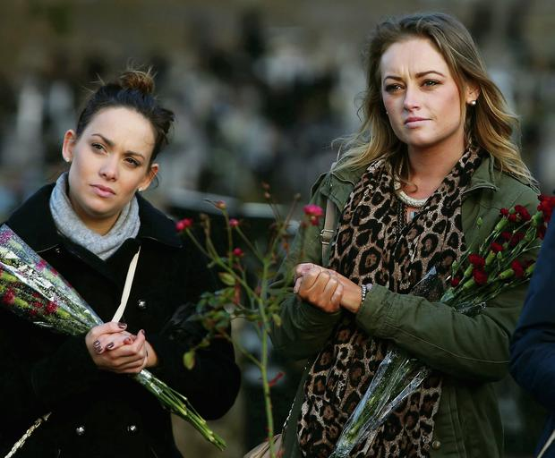Women at the flowers for Magdalenes remembrance event in Glasnevin cemetery, Dublin
