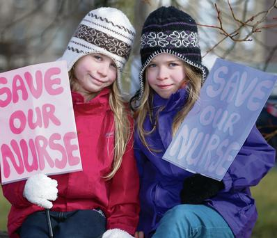 Seven-year-old twins Alyssa and Rianna Kelly from Manorcunningham who both suffer from Diabetes protesting during Minister Reilly's visit to Letterkenny General Hospital.