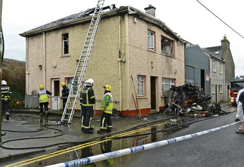 Firefighters at the scene of the fatal blaze in Gort, Co Galway. Picture: Joe Travers