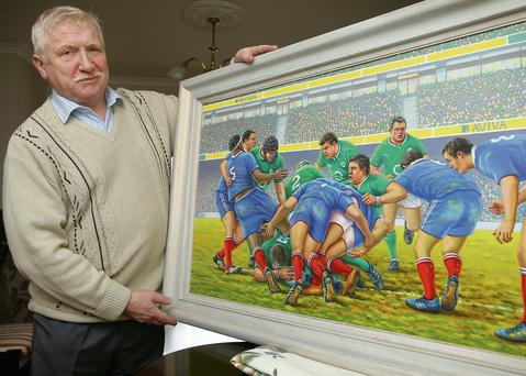 Leo Clancy, from Rathcoole, Co Dublin, pictured with his painting entitled 'BOD' which depicts Brian O'Driscoll at the centre of the action against France
