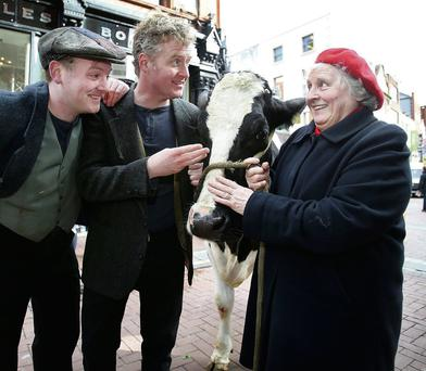 Actors Damien Kearney and Stephen Jones pictured with Rhonda a Nine year old Friesian cow and Bridie Loughlin from Newbridge, and owner of Rhonda, on Dublins Chatham Street.