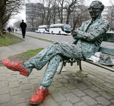 The vandalised Patrick Kavanagh statue by the Grand Canal