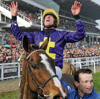 Davy Russell celebrates winning the BetFred Cheltenham Gold Cup Chase on Lord Windermere