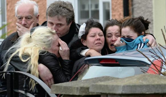 The grief-stricken family of Mary Dargan (inset), including her daughter Karina (third from right) at the scene of the shooting in Killinarden Estate, Tallaght, Dublin. Caroline Quinn