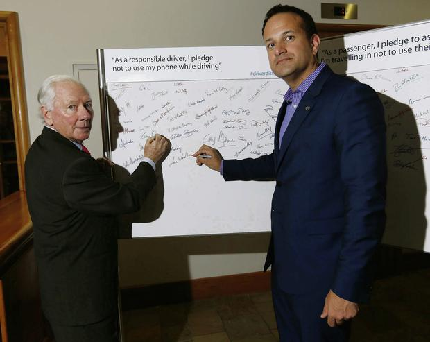 Broadcaster and RSA chairman Gay Byrne with Transport Minister Leo Varadkar launcing the pledge campaign not to use your phone while driving.