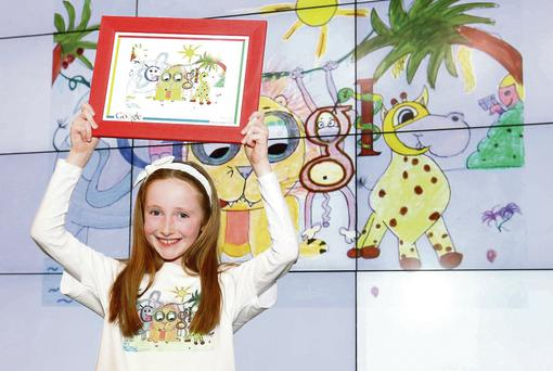 Kelly McCabe (8) from Scoil Carmel Junior National School, Firhouse, Co Dublin, with her winning Google doodle.