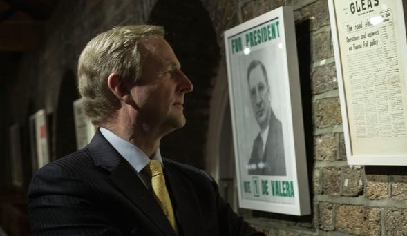 Enda Kenny inspects a poster from a collection of political ephemera on display at the National Print Museum