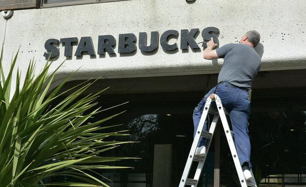Starbucks sign going up at Anglo HQ.