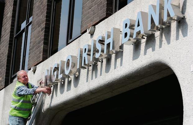 A workman removing signage from Anglo Irish Bank headquarters at St Stephen's Green in Dublin in 2011