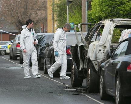 Members of the Gardai at the scene following a car blast at Long Lane, Dublin. Photo: Gareth Chaney Collins