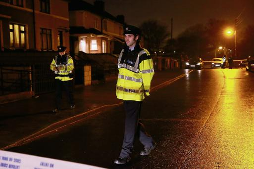 Gardai on patrol at the scene of the shooting in the Dublin suburb of Ballyfermot.