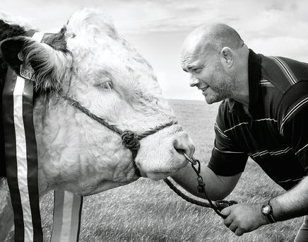 John 'The Bull' Hayes goes face to face with a bull in one of the portraits.