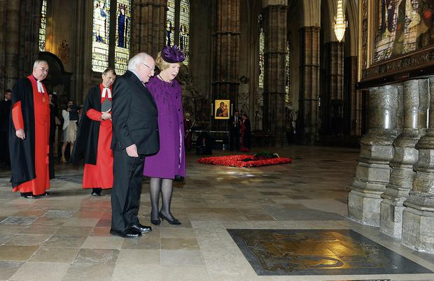The Very Reverend Dr. John Hall, Dean of Westminster , The Reverend Canon Professor Vernon White, President Michael D Higgins and Sabina Higgins pause at the grave of the Earl and Countess Mountbatten of Burma during the Presiden'ts visit to Westminster Abbey, where he laid a wreath on the grave of the Unknown Warrior. Picture Malcolm McNally.