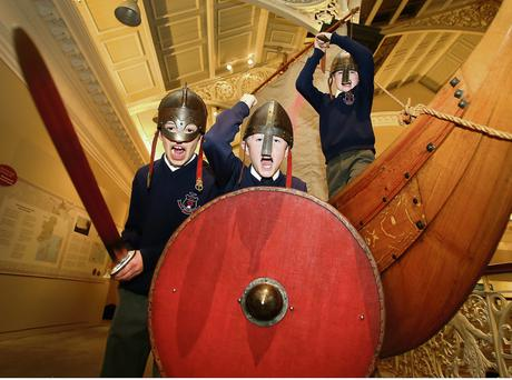 CUS Leeson St students Samuel Byrne, James Murphy and Paul Woods, (all 10 years old) pretend to be marauding Vikings at the launch of the National Museum and Trinity College Dublin celebration of Brian Boru and the Battle of Clontarf