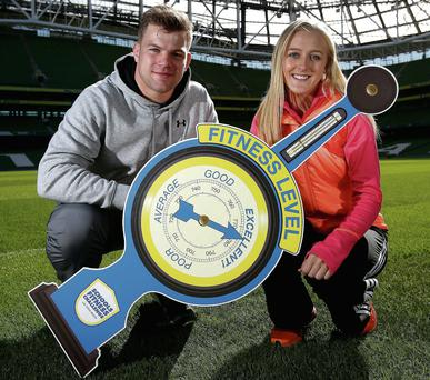 Rugby star Jordi Murphy and athlete Sarah Lavin at the Aviva Stadium yesterday tp announce the winners of this year's Aviva Health's Schools' Fitness Challenge. Photo: Dan Sheridan/INPHO