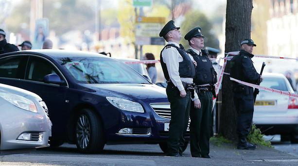 PSNI officers at Springfield Road in West Belfast after dissident republican Tommy Crossan was shot dead. Photo: Kelvin Boyes