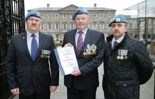 John J O Mahony (centre), Paul Clarke and Robbie Masterson handed in a presentation on the incident at Leinster House.
