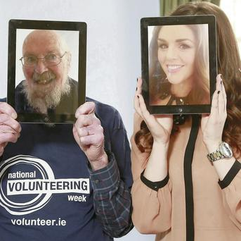 Presenter Sile Seoige and pensioner Nick Corish playing around with iPads. Conor Healy