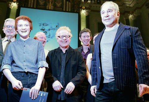 Paul Simon (right) with Niall O'hAnnagain (left), 15, from Letterkenny, singer Paul Brady, and other guests at the Seamus Heaney celebrations at the National Concert Hall in Dublin. Photo: Arthur Carron