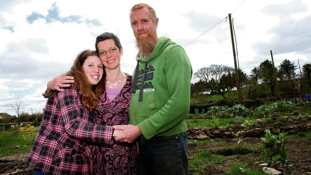 CONCERN: Josie Fleming with her mother Maria Fleming and stepfather Paul Cole in Ballaghaderreen, Co Roscommon - the couple say Josie would be disturbed by the noise from pylons. Photo: Brian Farrell
