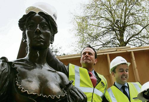 Minister Leo Varadkar, and Minister of State for the Office of Public Works, Brian Hayes, (right) mark the removal of the Molly Malone statue from its current home on Grafton Street.	Brian Lawless/PA Wire