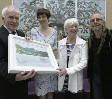 Arts Minister Jimmy Deenihan, artist Sheelagh McShane, artist Maria Kilgannon and Guggi at the launch of 'Art Walk' at St Lukes Oncology Centre in Beaumont Hospital, Dublin, yesterday. Picture: Karen Morgan