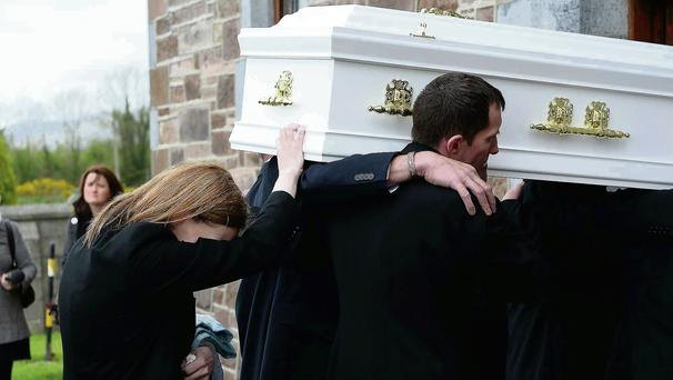 Liam's mum Mary places a hand on his coffin