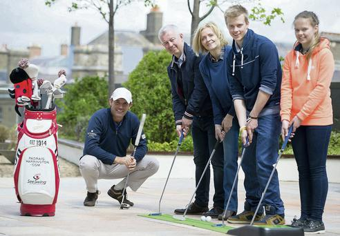 Paidraig Harrington with the Brown family: Des and Paivi, their son Henry and daughter Anna