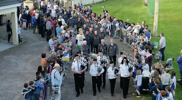 Locals welcome the Sam Maguire Cup into Keel GAA Grounds in Co Kerry. Picture: Domnick Walsh