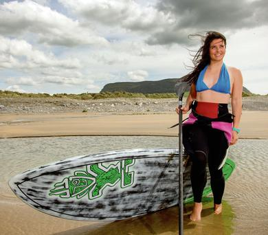 STAND UP GAL: Katie McAnena at Strandhill, Co Sligo, training for the Battle of the Bay. Photo: James Connolly