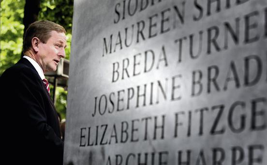 Taoiseach Enda Kenny at the memorial on Talbot Street, Dublin, to the victims of the Dublin and Monaghan bombings of 1974. Photo: David Conachy