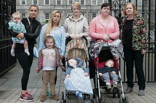 Worried mothers (from left) Maggie Stapleton, Philomena Deanes, Tami Cronin and Tamara Kearns with Councillor Ruth Coppinger at Leinster House