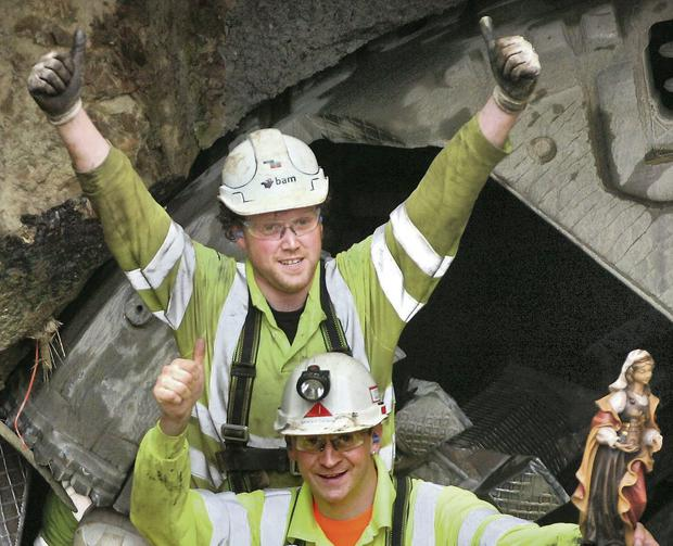 A thumbs up from tunnelling workers Thomas Healy and Thomas Gander. Photo: Henry Wills