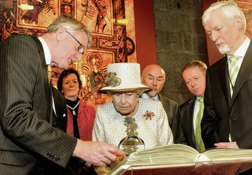 Queen Elizabeth and Prince Philip are shown the Book of Kells during a visit to Trinity College Dublin on May 17, 2011