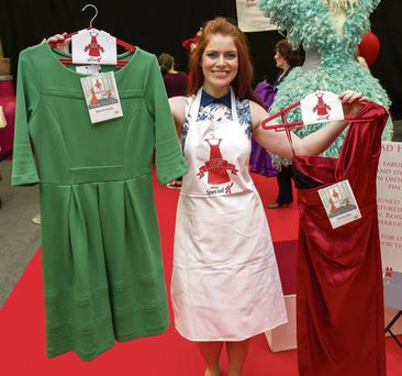 Niamh Doyle with dresses from Marion Keyes (green) and Imelda May (red)