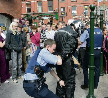 A man is arrested after an off-duty garda foiled a bank raid in Co Louth. Photo: Colin Bell