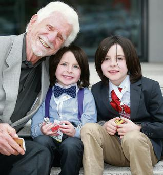Marty Cooper with Tim (4) and Luke Lally (8) at the Excited Digital Learning Festival. Photo: Arthur Carron