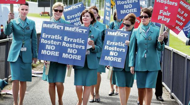 Aer Lingus cabin crew protesting at the roundabout outside Dublin Airport yesterday.
