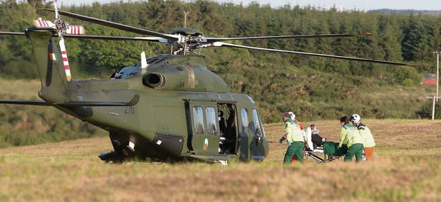 An injured woman is transferred to an air ambulance after a motorcycle collision near Ennistymon, Co Clare. Photo: Press 22