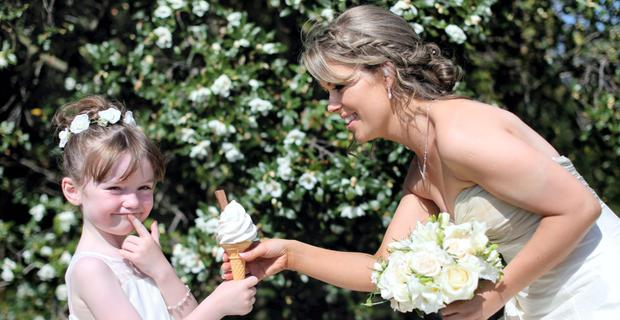 New Bride Aideen Carey from Finglas enjoys an ice cream with her daughter and flower girl Amelia Daisy (6) as they stop for photos in National Botanic Gardens Dublin on one of the hottest days so far this year.